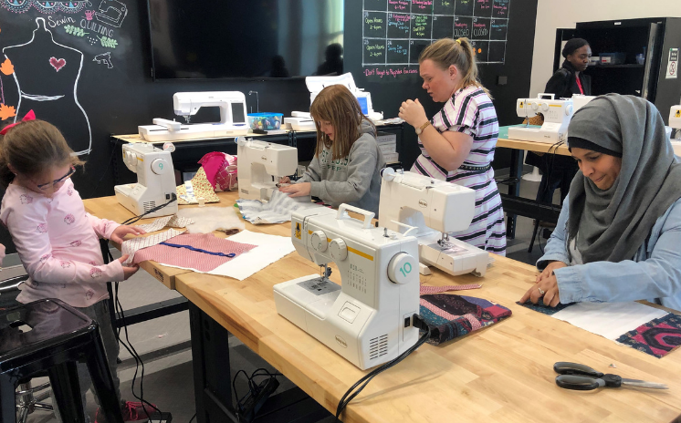 Youth working with sewing machines